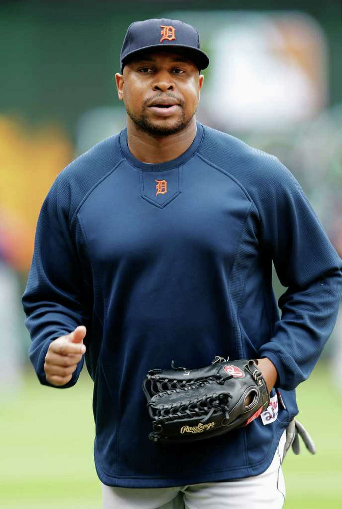Detroit Tigers' Delmon Young jogs on the field before Game 2 of baseball's American League championship series against the Texas Rangers Monday, Oct. 10, 2011, in Arlington.