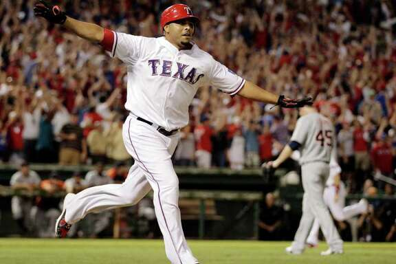 Texas Rangers' Nelson Cruz reacts after hitting a grand slam home run off of Detroit Tigers Ryan Perry, rear to win Game 2 of baseball's American League championship series 7-3,  Monday, Oct. 10, 2011, in Arlington.