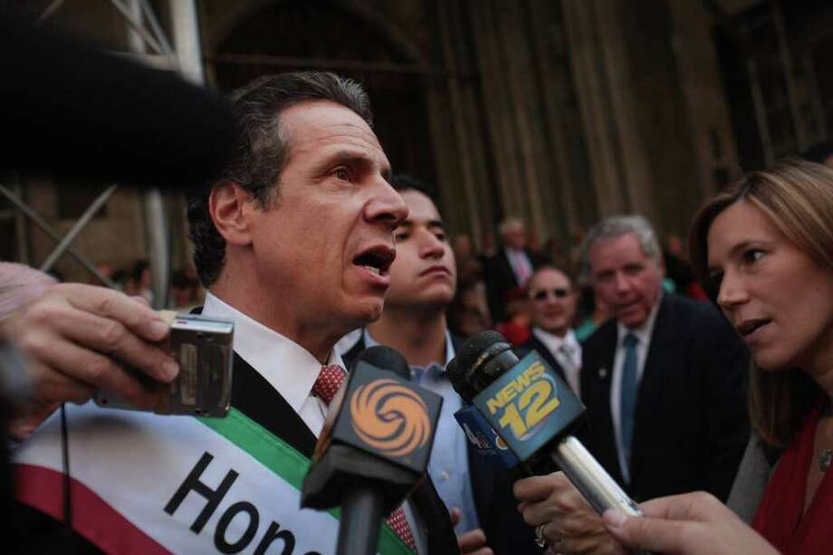 NEW YORK, NY - OCTOBER 10:  New York Governor Andrew Cuomo speaks to the media along the route of the 67th annual Columbus Day Parade on October 10, 2011 in New York City. The annual celebration of Italian-American culture travels north along Fifth Avenue from 44th Street to 79th Street beginning at 11:30 a.m. This year over 35,000 marchers are expected to participate in the parade.  (Photo by Spencer Platt/Getty Images) Photo: Spencer Platt