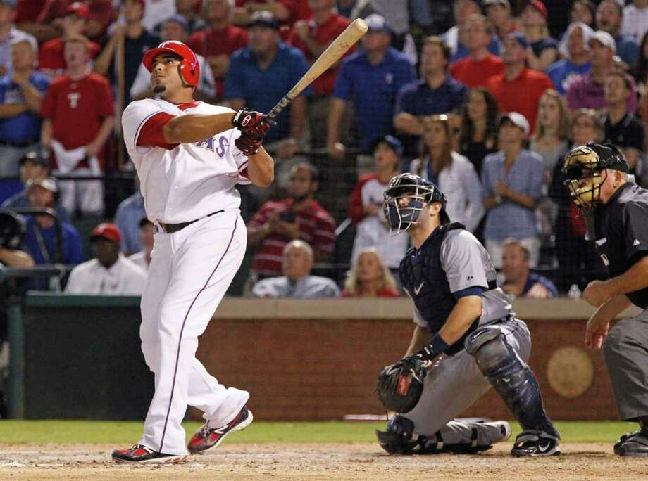 RON T. ENNIS: McCLATCHY-TRIBUNE ADMIRATION: The Rangers' Nelson Cruz takes a long look at the biggest homer of his career. Photo: Ron T. Ennis / Fort Worth Star-Telegram