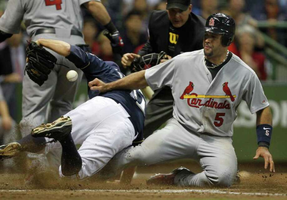 Albert Pujols of the St. Louis Cardinals scores on a wild pitch in the top of the 5th against Marco Estrada of the Milwaukee Brewers in the second during Game 2 of the National League Championship Series at Miller Park in Milwaukee, Wisconsin, on Monday, October 10, 2011. (Rick Wood/Milwaukee Journal Sentinel/MCT) Photo: Rick Wood / Milwaukee Journal Sentinel
