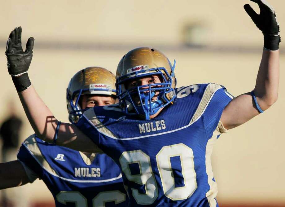 Alamo Heights' Skylar Nelson celebrates after a sack last season. Nelson recorded 22 tackles, a sack and the victory-clinching interception with three minutes remaining to lead the Mules to a 14-10 victory against New Braunfels Canyon. Photo: Darren Abate/Special To The Express-News