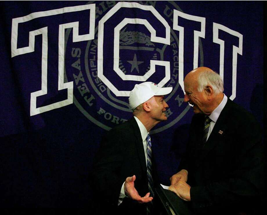 Texas Christian Chancellor Victor J. Boschini Jr. (left, wearing a Big 12 cap) laughs with Big 12 Interim Commissioner Chuck Neinas after a press conference in Fort Worth announcing TCU's acceptance of an invitation to join the Big 12 Conference Monday, Oct. 10, 2011. Photo: AP Photo/Fort Worth Star-Telegram,  Ian McVea