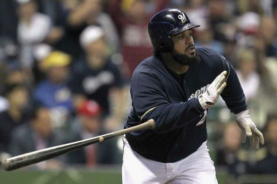 MILWAUKEE, WI - OCTOBER 10:  Prince Fielder #28 of the Milwaukee Brewers hits a double in the bottom of the fourth ining against the St. Louis Cardinals during Game Two of the National League Championship Series at Miller Park on October 10, 2011 in Milwaukee, Wisconsin. Photo: Jonathan Daniel, Getty / 2011 Getty Images