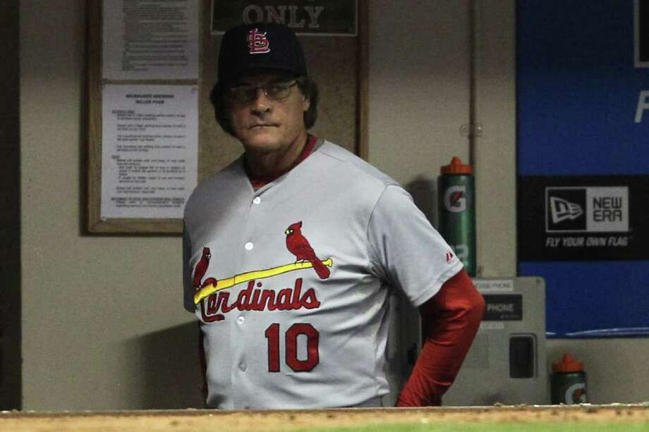 MILWAUKEE, WI - OCTOBER 10:  Manger Tony LaRussa #10 of the St. Louis Cardinals looks on from the dugout against the Milwaukee Brewers during Game Two of the National League Championship Series at Miller Park on October 10, 2011 in Milwaukee, Wisconsin. Photo: Jonathan Daniel, Getty / 2011 Getty Images
