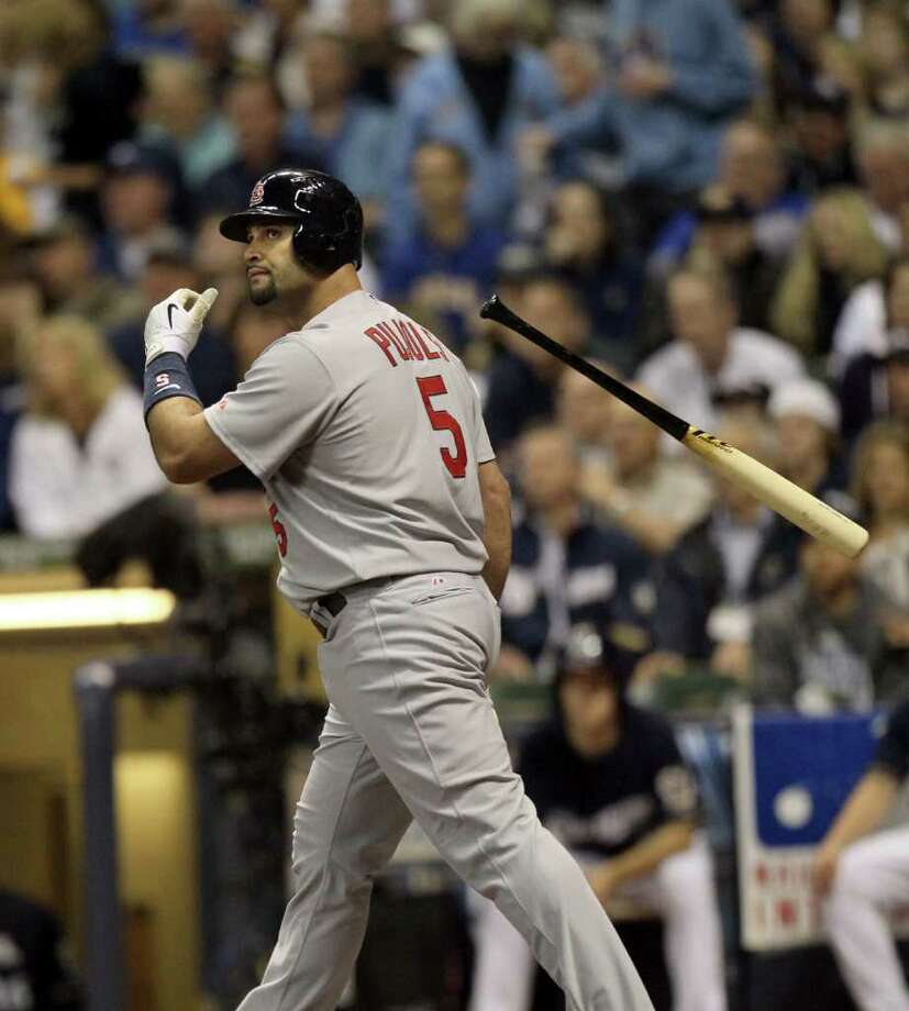 Albert Pujols of the St. Louis Cardinals watches the flight of his two-run homer against the Milwaukee Brewers in the first inning of Game 2 of the National League Championship Series at Miller Park in Milwaukee, Wisconsin, on Monday, October 10, 2011. (Chris Lee/St. Louis Post-Dispatch/MCT) Photo: Chris Lee, McClatchy-Tribune News Service / St. Louis Post-Dispatch