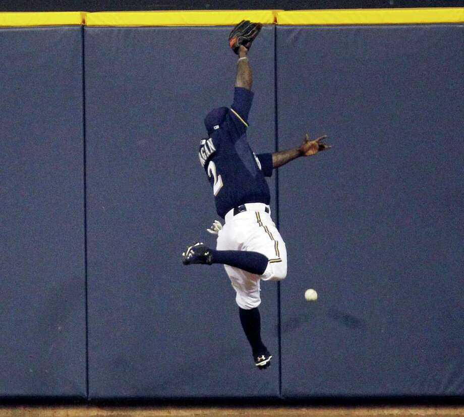 Nyjer Morgan of the Milwaukee Brewers miss judges a fly ball by Albert Pujols of the St. Louis Cardinals and 2 runs scores on the play in the 3rd during Game 2 of the National League Championship Series at Miller Park in Milwaukee, Wisconsin, on Monday, October 10, 2011. (Rick Wood/Milwaukee Journal Sentinel/MCT) Photo: Rick Wood, McClatchy-Tribune News Service / Milwaukee Journal Sentinel