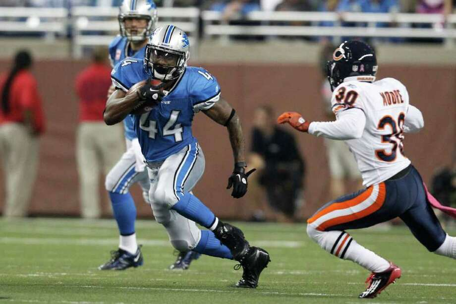 Oct. 10: Lions 24, Bears 13 Detroit Lions running back Jahvid Best (44) runs the ball at Chicago Bears defensive back D.J. Moore (30) in the second quarter of an NFL football game in Detroit, Monday, Oct. 10, 2011. (AP Photo/Rick Osentoski) Photo: Rick Osentoski, Associated Press / Rick Osentoski
