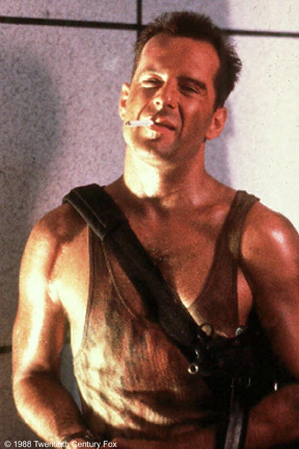 Bruce Willis as John McClane in Die Hard.