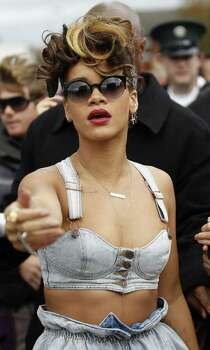 "Pop star Rihanna arrives for filming in the New Lodge area of North Belfast, Northern Ireland, Tuesday, Sept. 27, 2011. Northern Ireland farmer Alan Graham says he doesn't know who Rihanna is but she must keep her top on while performing on his land. Graham says he enforced a dress code as he watched Rihanna shoot a video Monday in his wheat field in Bangor, east of Belfast, for her new single, ""We Found Love."" She's in Northern Ireland this week to perform three concerts. Photo: Peter Morrison, AP / AP"