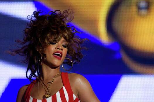 Rihanna performs during the Rock in Rio music festival in Rio de Janeiro, Brazil, early Saturday Sept.  24, 2011. The festival, which runs through Oct. 2, includes Katy Perry, Rihanna, Stevie Wonder, Red Hot Chili Peppers, Metallica, Guns N' Roses and Coldplay. Photo: AP