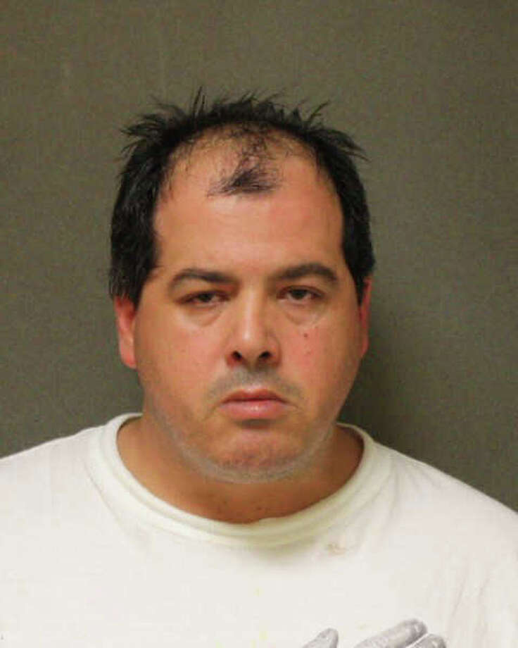 Andrew Sporko, 41, was charged after police said he wielded a shotgun while patroling his street, fed up with erratic drivers racing around his neighborhood. Photo: Contributed Photo / Connecticut Post Contributed