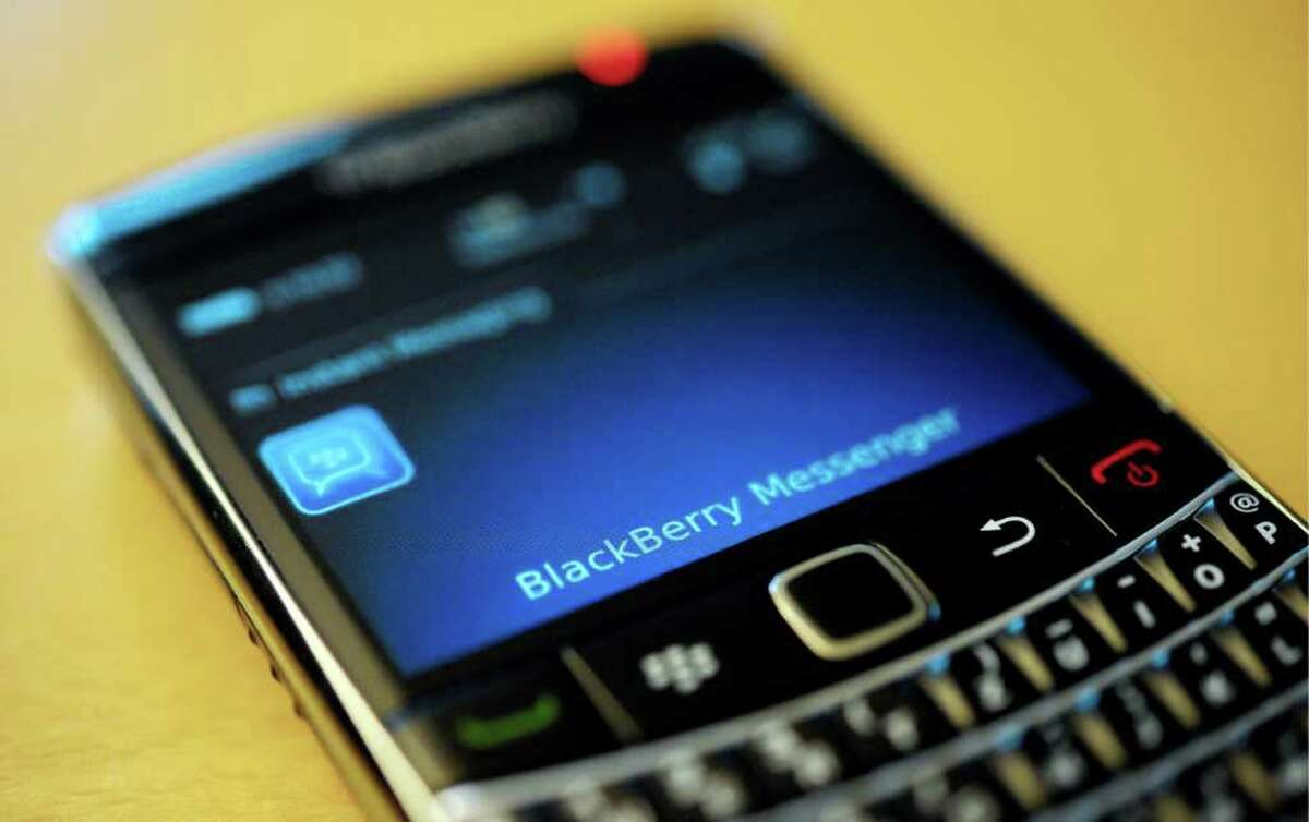 FILE - This file photo taken Sept. 8, 2011, shows a BlackBerry smartphone using the