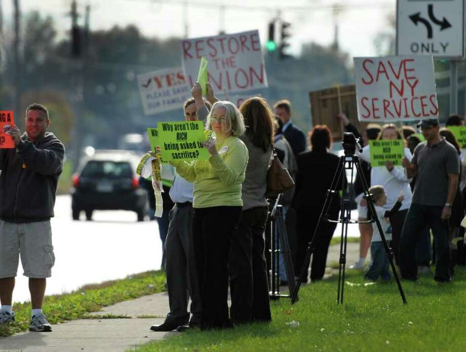 Advocates for members of PEF that are facing layoffs rally in front of the Public Employee Federation offices in Latham, N.Y.  October 10, 2011.   (Skip Dickstein / Times Union) Photo: SKIP DICKSTEIN / 00014925A