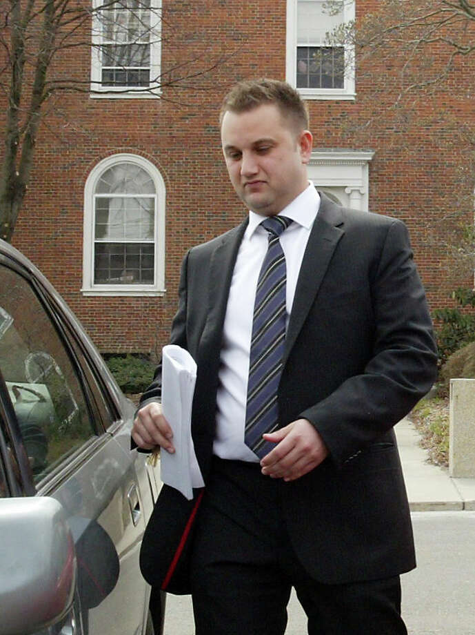 Stratford Police Officer Justin LoSchiavo leaves Stratford Town Hall, Thu., March 25, 2010, after facing a disciplinary hearing. LoSchiavo had been on light duty for seven months after having a seizure, but a Superior Court judge ruled on Tuesday, Oct. 11, 2011 that the town needed to reinstate him. Photo: Phil Noel, ST / Connecticut Post