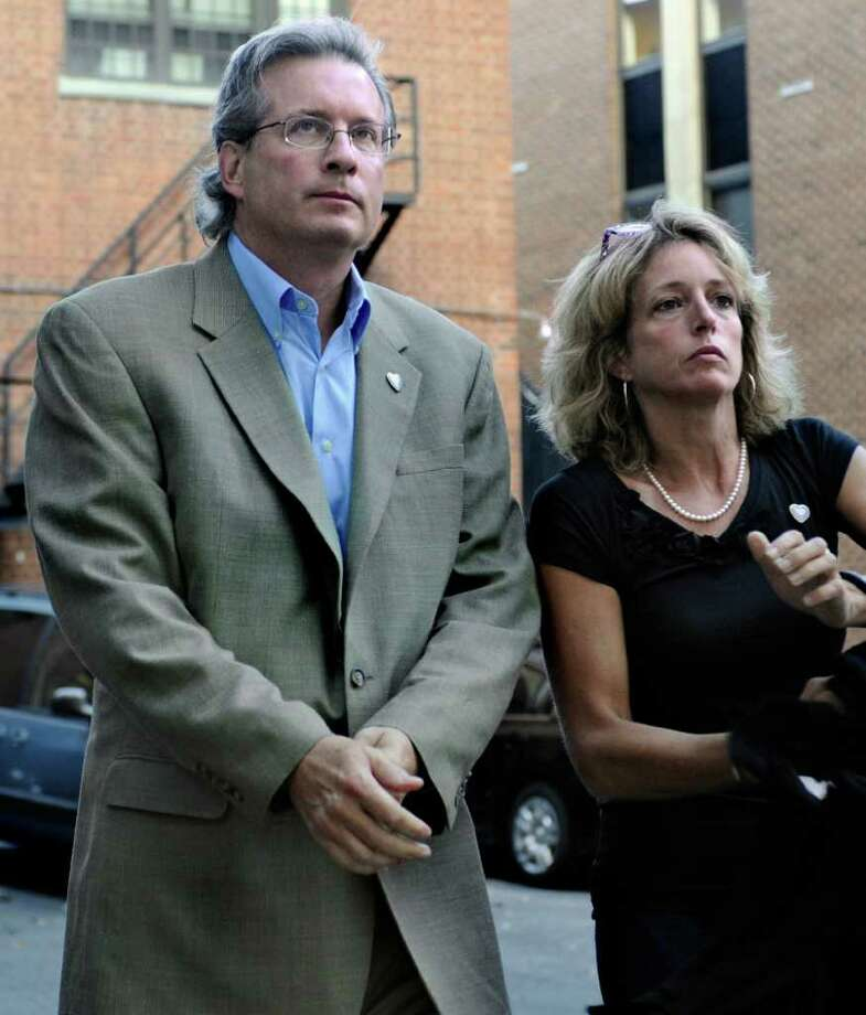 Dr. William Petit Jr., left, and his sister Johanna Chapman arrive at the New Haven Superior Court for closing arguments in the trial of Joshua Komisarjevsky on Tuesday, Oct. 11, 2011,  in New Haven, Conn.  Petit is the sole survivor of the 2007 Cheshire, Conn., home invasion where his wife, Jennifer Hawke-Petit, and their daughters, Hayley and Michaela, were murdered. (AP Photo/Jessica Hill) Photo: Jessica Hill, Associated Press / AP2011