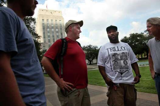 Scott Gregory, Rapper Bun B, and Darin Williams discuss politics as they participate in Occupy Houston where protesters staging at City Hall on Tuesday, Oct. 11, 2011, in Houston. Photo: Mayra Beltran, Houston Chronicle / © 2011 Houston Chronicle