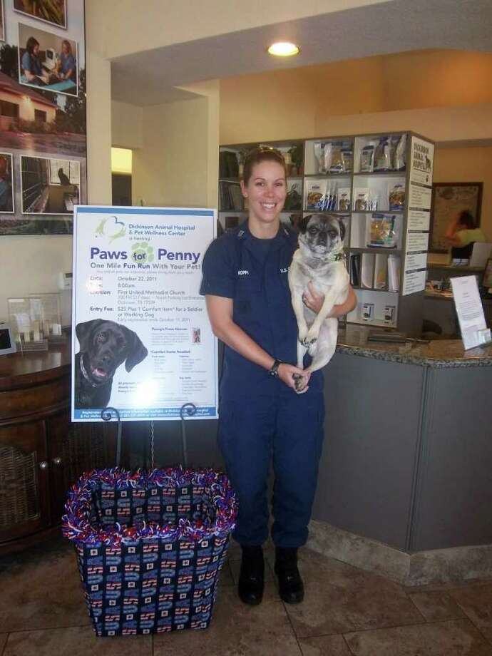 COURTESY  ONE FOR ALL: U.S. Coast Guard Lt. Jamie Koppi, with  Buddy  her 7- year-old pug, will take part in the Paws for Penny Fun Run. Photo: COURTESY Kelli Rawls