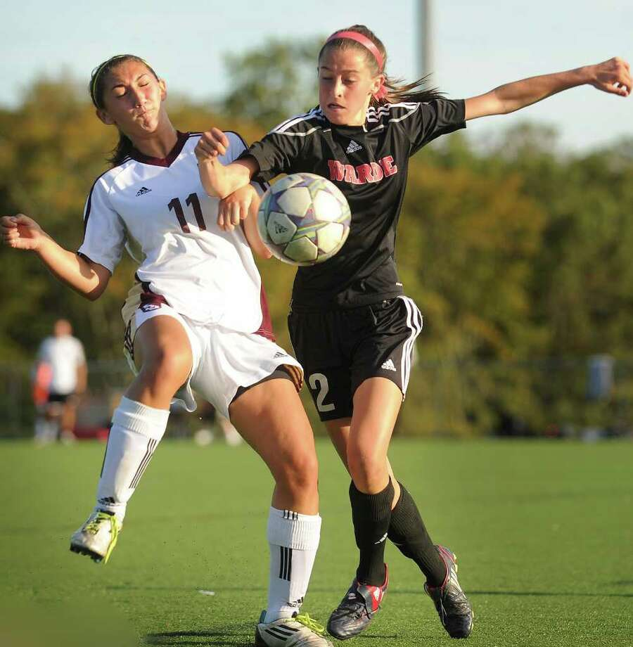 St. Joseph's Sara Chille, left, and Fairfield Warde's Katie Tangney converge on the ball during their matchup at Indian Ledge Park in Trumbull on Monday, October 10, 2011. Photo: Brian A. Pounds / Connecticut Post