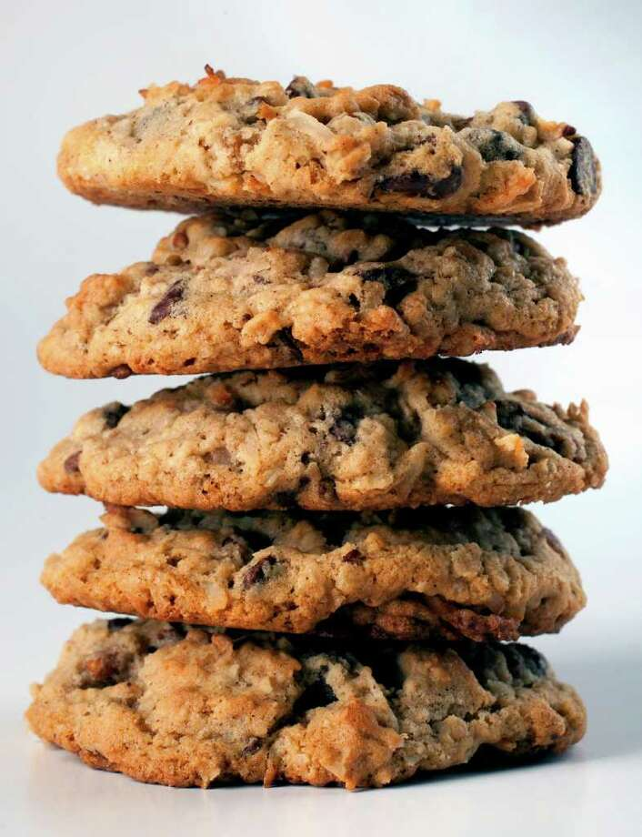 CODY DUTY : STAFF FULLY LOADED: Texas Governor's Mansion Cowboy Cookies are bursting with flavor from loads of oats, chocolate chips, nuts and coconut. Photo: Cody Duty / © 2011 Houston Chronicle