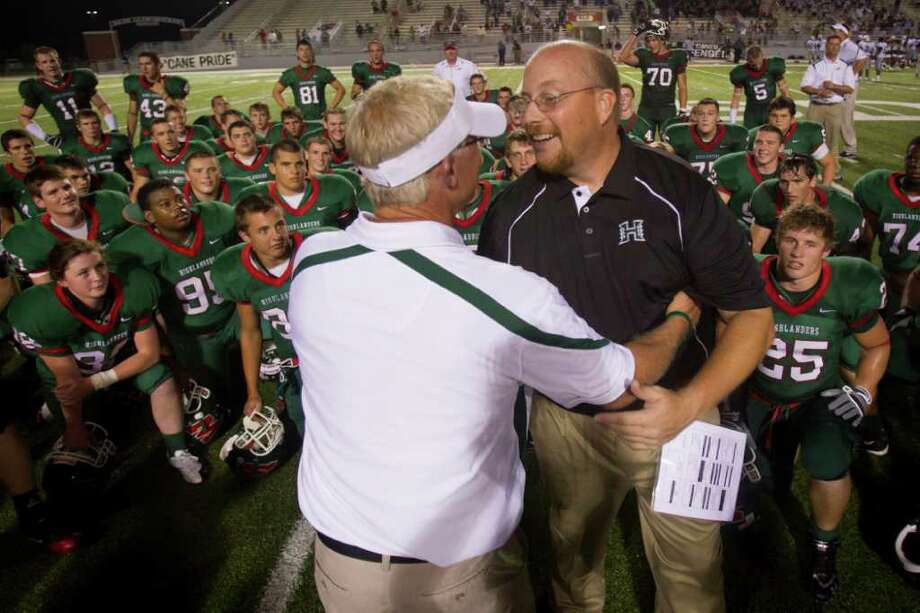 Hightower coach Barry Abercrombie, right, congratulates The Woodlands coach Mark Schmid  after the Highlanders overtime victory  in high school football action against The Woodlands at Woodforest Stadium Friday, Sept. 3, 2010, in Shenandoah. The Woodlands won the game 46-39 in double overtime. ( Smiley N. Pool / Houston Chronicle ) Photo: Smiley N. Pool / Houston Chronicle