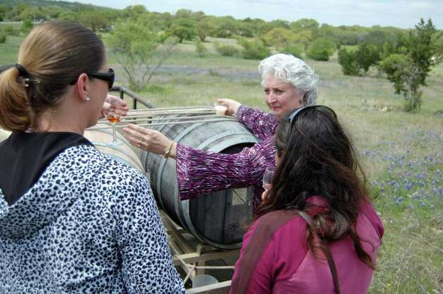 Sabrina Houser, co-owner of Dry Comal Creek Vineyards and Winery in New Braunfels, attended the Texas Hill Country Wines road show and talked about making 1096 Port, named for the number of days it sits outdoors in small oak casks. COURTESY PHOTO