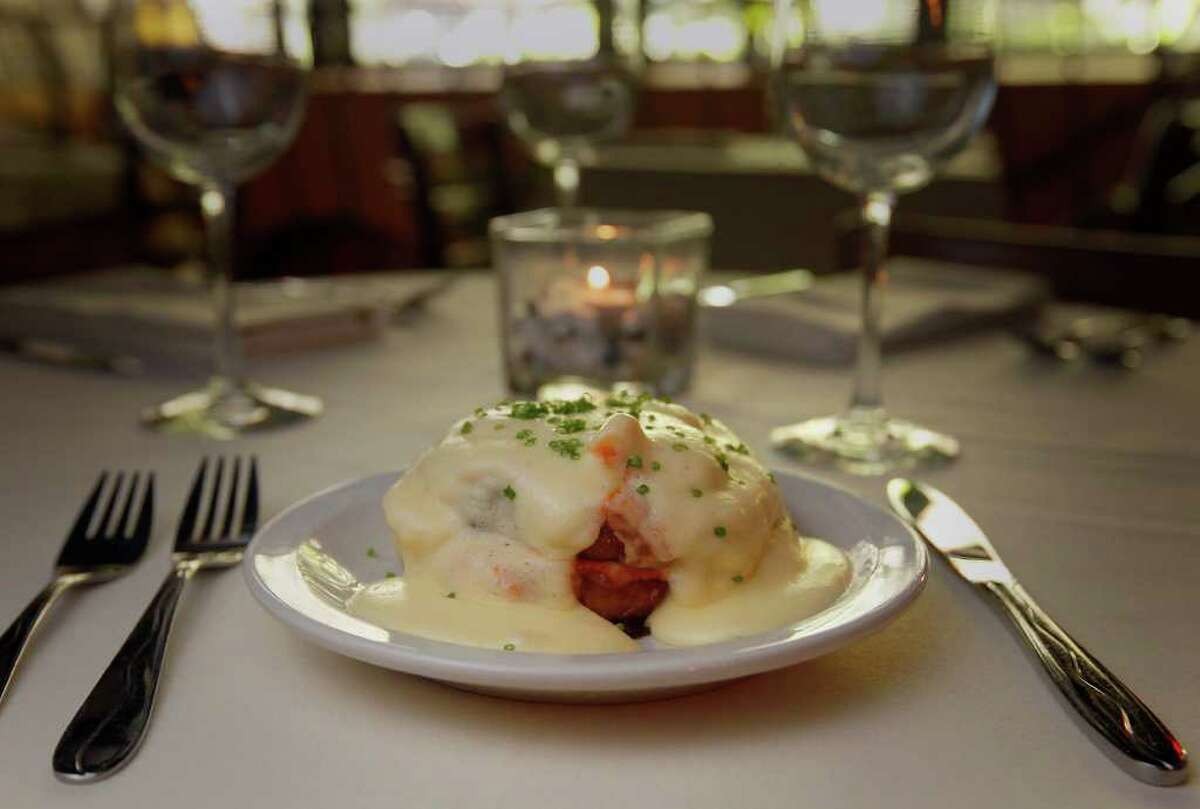 Eggplant Josephine is one of Bella on the River Restaurant's signature dishes. The appetizer features sliced, fried eggplant smothered in sauce diablo, mozzarella, sauteed shrimp and hollandaise sauce. KIN MAN HUI / EXPRESS-NEWS