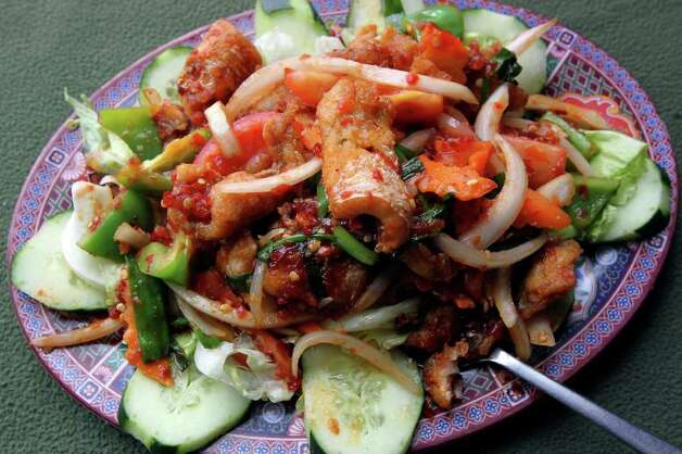 The Vietnamese fish saute with onion is spicy but not overwhelming. TOM REEL / EXPRESS-NEWS Photo: TOM REEL, SAN ANTONIO EXPRESS-NEWS / © 2011 San Antonio Express-News