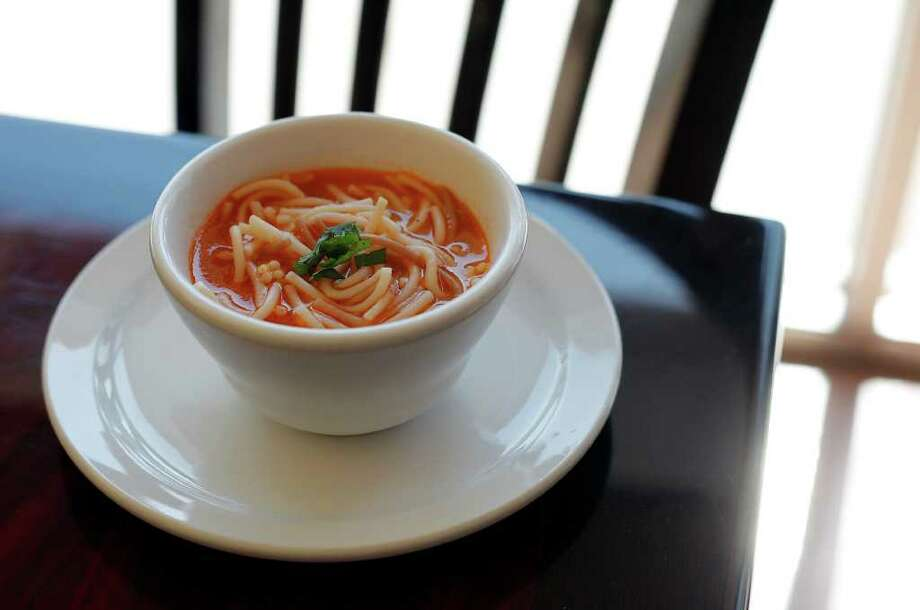 Vida Mia's fideo recipe is from Guadalajara. This dish incorporates a slightly spicy bean broth with short noodles almost the thickness of spaghetti. KIN MAN HUI / EXPRESS-NEWS Photo: Kin Man Hui, SAN ANTONIO EXPRESS-NEWS / San Antonio Express-News