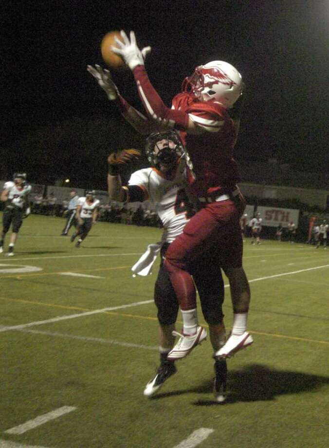 TONY BULLARD: FOR THE CHRONICLE SURE HANDS: St. Thomas' Cavan Biggio, right, leaps high to snare a reception at the 1-yard line over St. Pius' Chase Fontana earlier this season. Photo: Tony Bullard / Credit: for the Chronicle