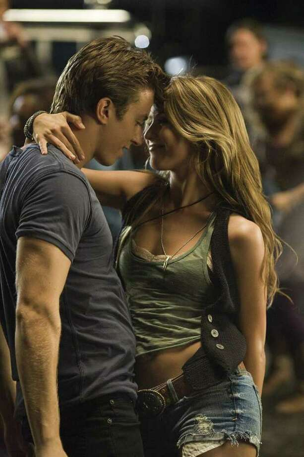 PARAMOUNT PICTURES ON THE FLOOR: Kenny Wormald stars as Ren McCormack and Julianne Hough as Ariel Moore in the remake of Footloose. / © 2011 Paramount Pictures