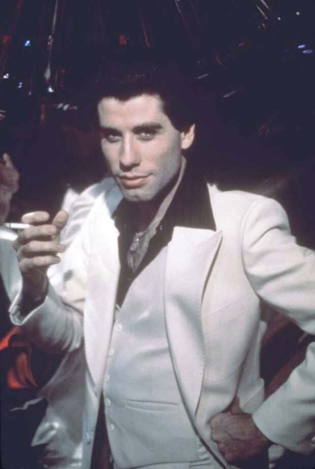 John Travolta in SATURDAY NIGHT FEVER.  HOUCHRON CAPTION (02/09/2005) SECSTAR COLOR:  TONY IN SATURDAY NIGHT FEVER.  HOUCHRON CAPTION (05/26/2005) SECPREVIEW COLOR:  Favorite Bee Gee: John Travolta, of course! / handout slide