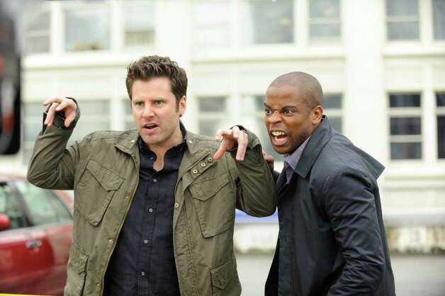 "James Roday and Dule Hill ham it up, vampire-style, for this season's Halloween episode of ""Psych."" USA NETWORK Photo: Alan Zenuk/USA Network"