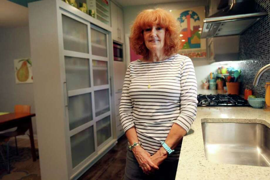 Judith Hyndman says her remodeled kitchen has transformed her house. Vintage Fiestaware influenced the color scheme. Photo: HELEN L. MONTOYA, San Antonio Express-News / SAN ANTONIO EXPRESS-NEWS