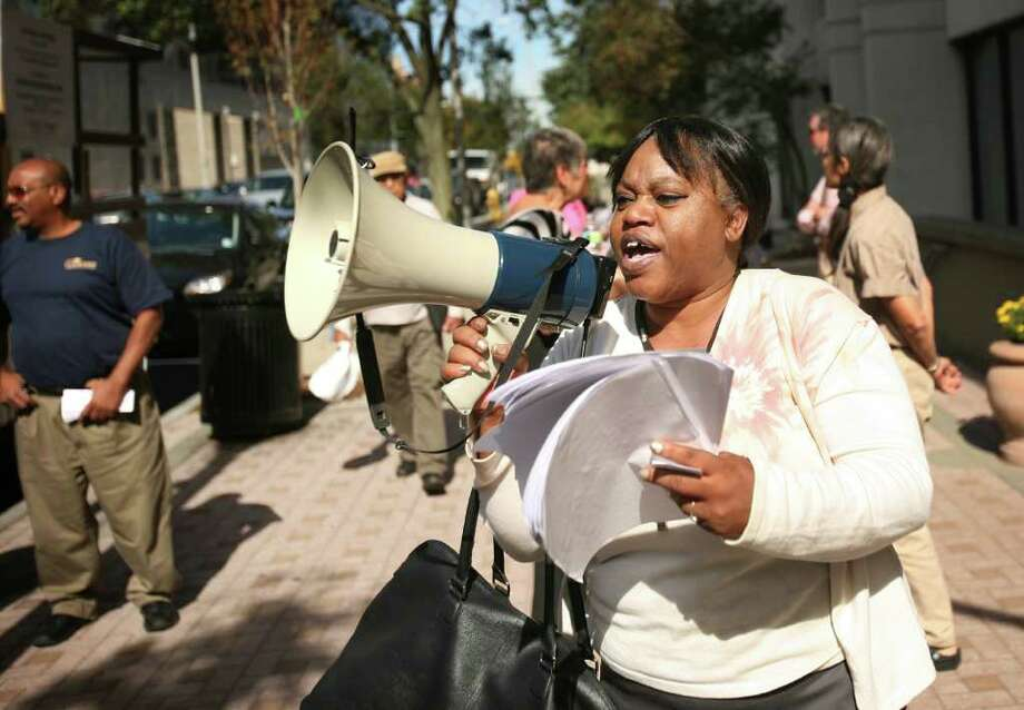 Andrea Arroyo of Bridgeport uses a megaphone to let her voice be heard during an Occupy Wall Street type protest outside 10 Middle Street in downtown Bridgeport on Tuesday, October 11, 2011. Photo: Brian A. Pounds / Connecticut Post