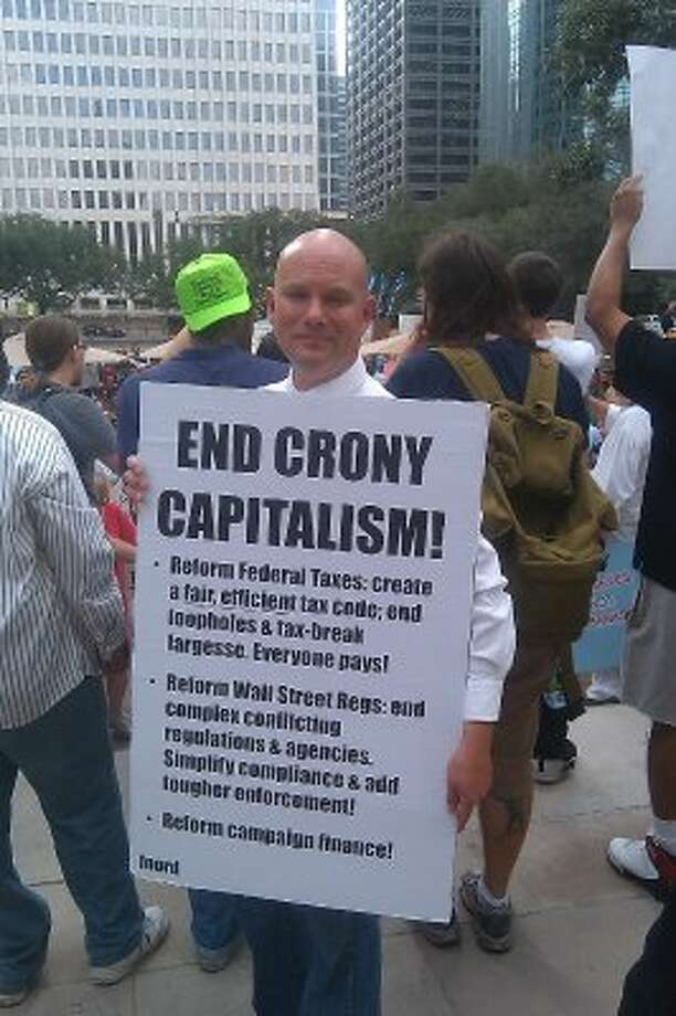 "Loren Steffy : Chronicle SAVING THE SYSTEM?: Christopher Keeble says capitalism has been hijacked. ""We need to stand up against a system that has been corrupted."" Photo: Loren Steffy"