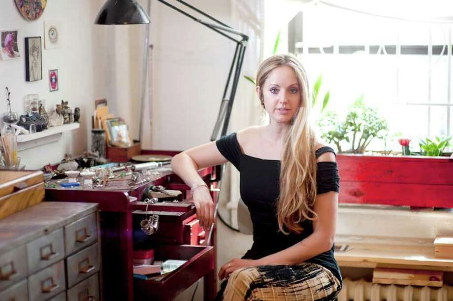 Jewelry designer Kimberlin Brown, who developed her artistic skills and affinity for nature growing up in Greenwich, sits at her work bench. The designer recently introduced her line at St. Germain on Greenwich Ave. - at the site of a store once owned by her grandfather. Photo: Contributed Photo