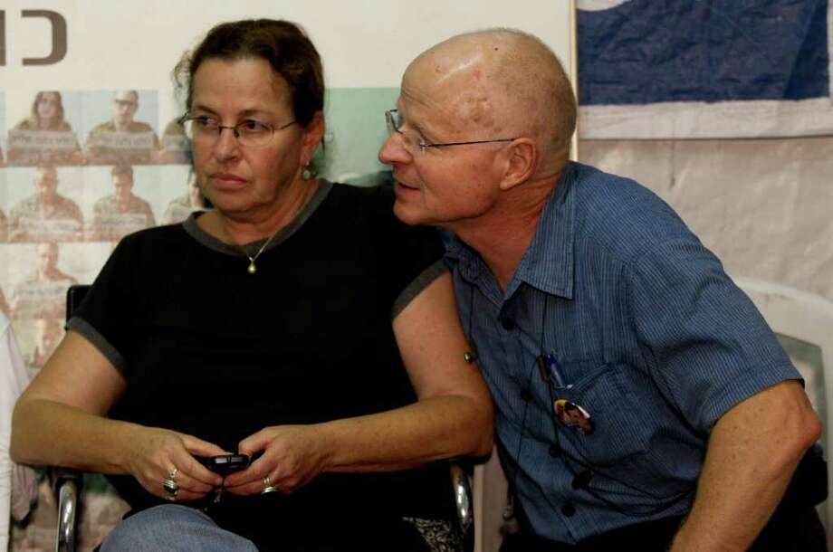 BERNAT ARMANGUE: ASSOCIATED PRESS PARENTS: Aviva and Noam Schalit, parents of captured Israeli soldier Sgt. Gilad Schalit, may be able to end their efforts to free their son. On Tuesday they sat in a protest tent. Photo: Bernat Armangue / AP