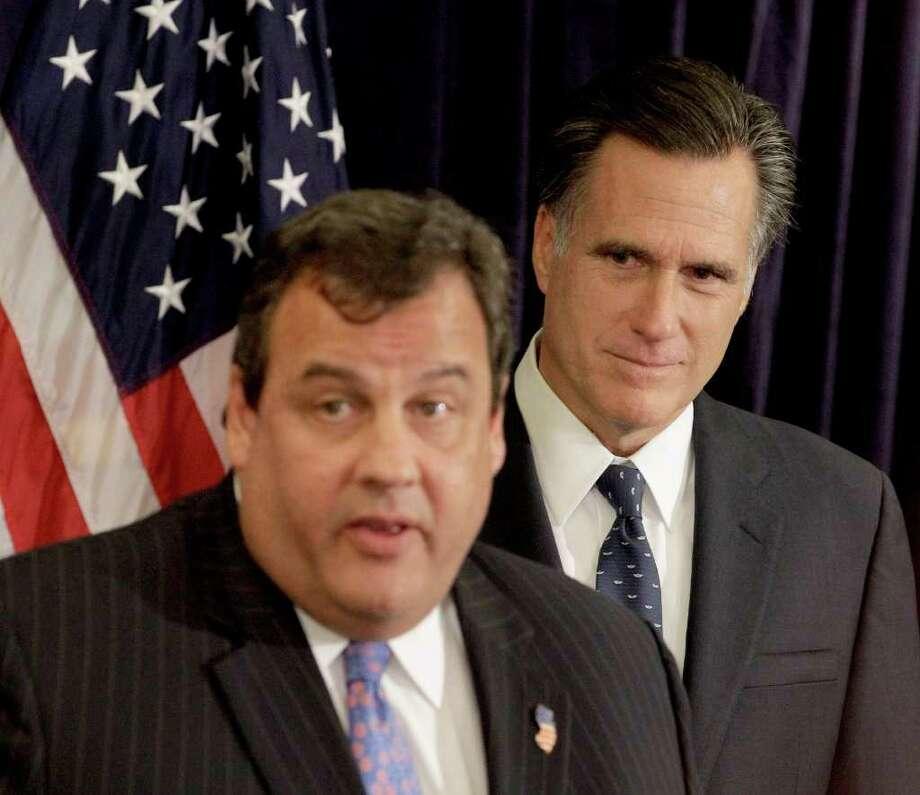 JUSTIN SULLIVAN : GETTY IMAGES  IN HIS CORNER: New Jersey Gov. Chris Christie endorses GOP presidential hopeful Mitt Romney in Lebanon, N.H. Photo: Stephan Savoia / AP