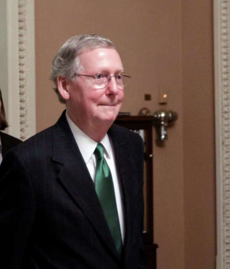 Senate Republican leader Mitch McConnell of Kentucky returns to his office during parliamentary maneuvering with Senate Majority Leader Harry Reid, D-Nev., just before the vote on President Barack Obama's $447 billion jobs bill, which is expected to fail in the Democrat-controlled Senate at the Capitol in Washington, Tuesday, Oct. 11, 2011. (AP Photo/J. Scott Applewhite) Photo: J. Scott Applewhite / AP