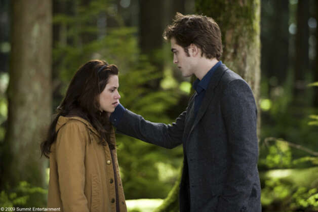 """Twilight"" solidified Stewart in the eyes of the world as the other half of Robert Pattinson. (That's Edward the vampire, of course.) Celebrity couple names: Kristbert or Bellward -- take your pick.  Here they are in ""New Moon,"" when things were still sweet and innocent. (Getty Images) Photo: Photo: Kimberley French / Copyright: 2009 Summit Entertainment. All rights reserved."