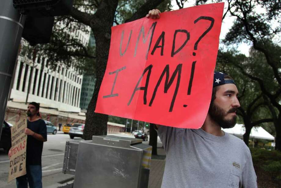 Leif Hayman, 22, of Houston, protest against corporate greed with Occupy Houston protesters at City Hall on Tuesday, Oct. 11, 2011, in Houston.  ( Mayra Beltran / Houston Chronicle ) Photo: Mayra Beltran / © 2011 Houston Chronicle