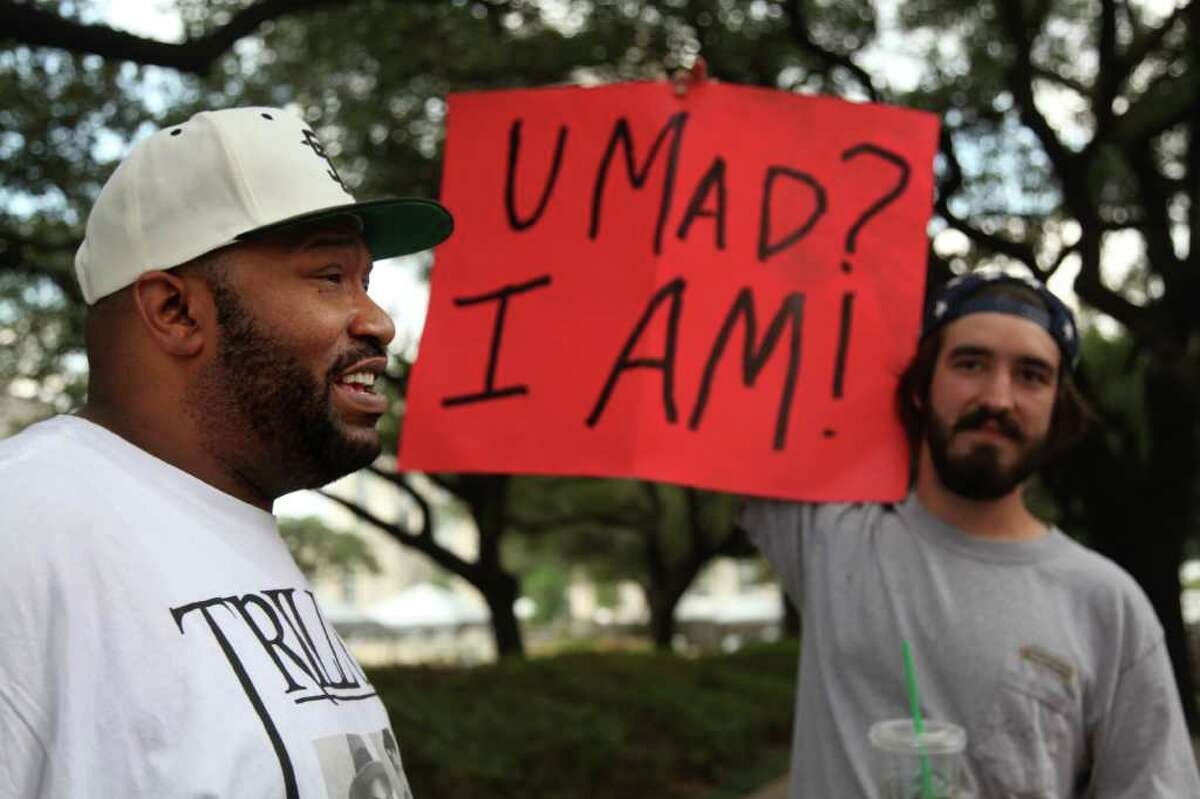 Rapper Bun B unites with Occupy Houston protesters staging at City Hall on Tuesday, Oct. 11, 2011, in Houston. (AP Photo/Houston Chronicle, Mayra Beltran)