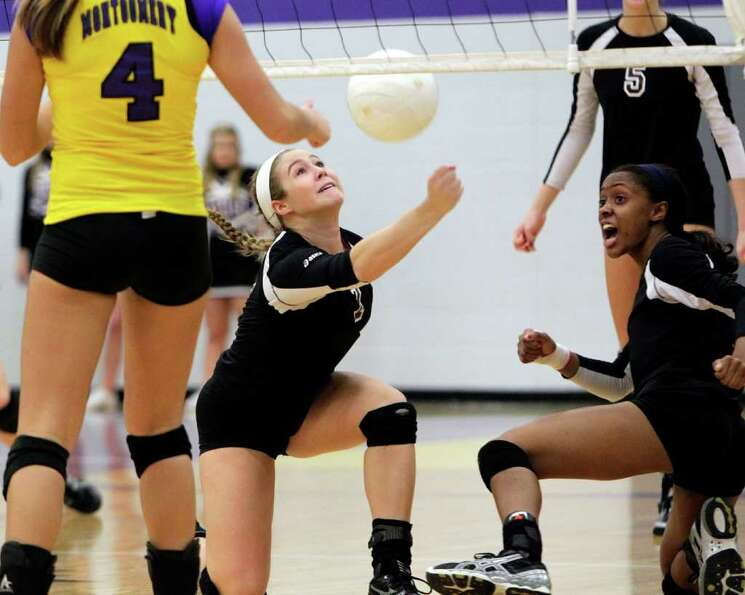 Magnolia's Madison Butler makes a play on the ball next to teammate Ambra Davis, right.