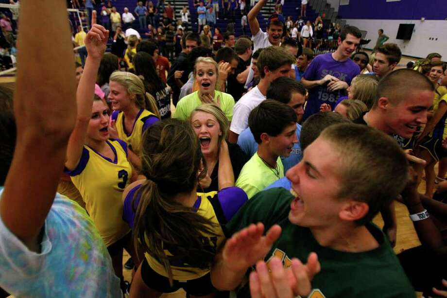 Montgomery High School fans rush onto the court to celebrate their team's 3-2 win over Magnolia High School. Photo: Johnny Hanson, Houston Chronicle / © 2011 Houston Chronicle
