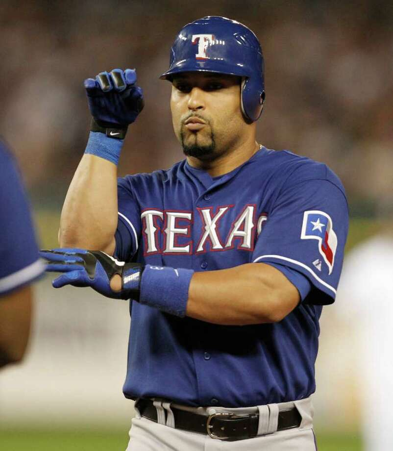 Texas Rangers' Yorvit Torrealba does the cobra after getting his second hit of the night. Photo: Ron Jenkins, McClatchy-Tribune News Service / Fort Worth Star-Telegram