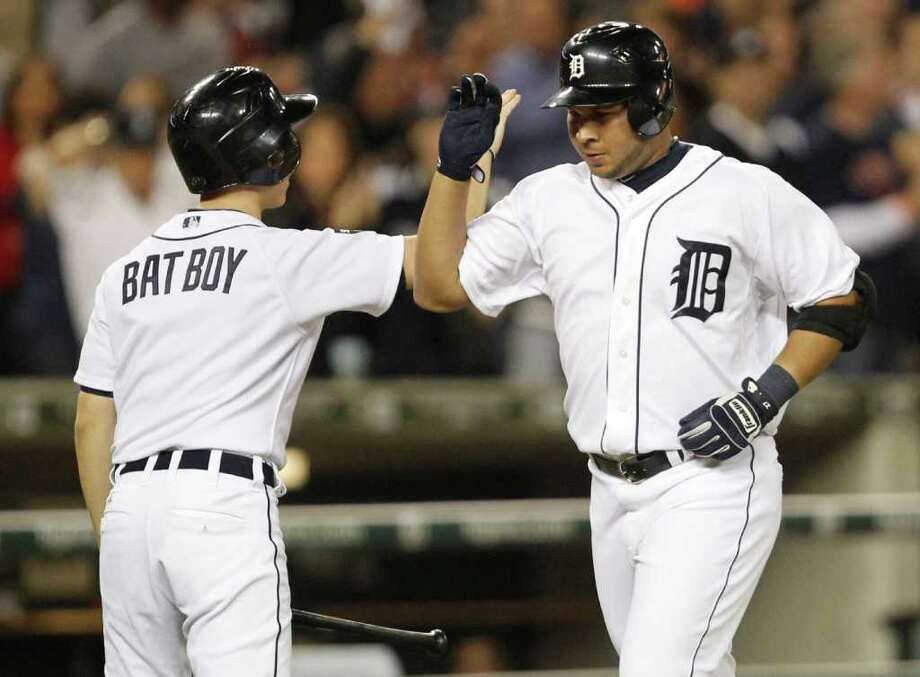 Game 3: Tigers 5, Rangers 2 (Rangers lead series 2-1) - Detroit Tigers' Jhonny Peralta, right, celebrates his home run in the sixth inning with the bat boy. Photo: Ron Jenkins, McClatchy-Tribune News Service / Fort Worth Star-Telegram
