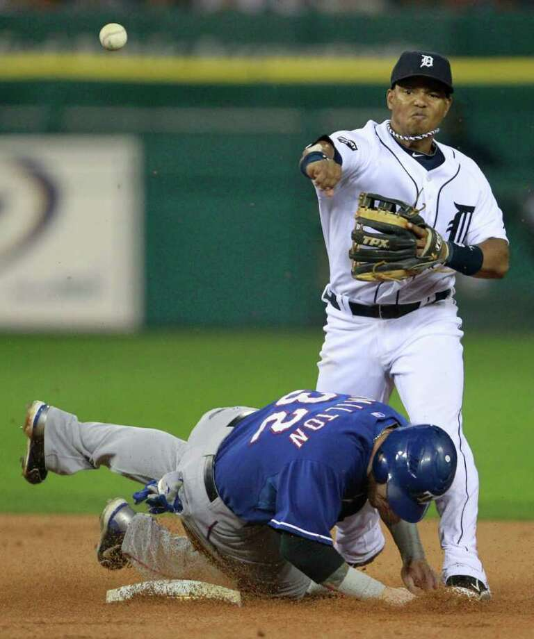 Texas Rangers' Josh Hamilton is forced out at second base by Detroit Tigers second baseman Ramon Santiago. Photo: Ron Jenkins, McClatchy-Tribune News Service / Fort Worth Star-Telegram