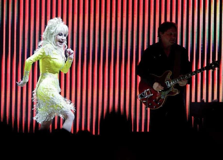 Dolly Parton performs at Verizon Wireless Theater, 520 Texas Ave., Tuesday, Oct. 11, 2011, in Houston. Photo: Melissa Phillip, Houston Chronicle / © 2011 Houston Chronicle
