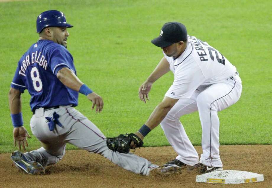 MARK DUNAN: ASSOCIATED PRESS CATCHING A CATCHER: The Tigers' Jhonny Peralta tags out the Rangers' Yorvit Torrealba. Photo: Mark Duncan / AP